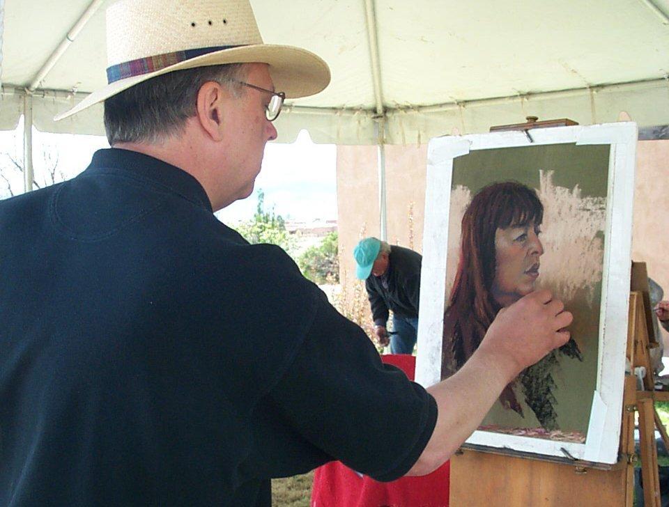 Mike Mahon paints portrait in Taos, NM